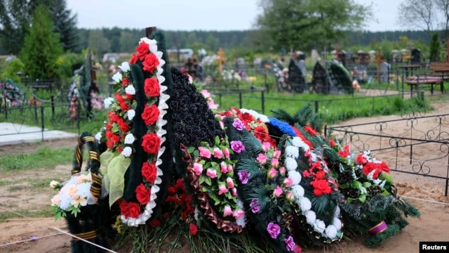 A freshly dug grave is seen at the Vybuty cemetery in the Pskov region on August 27.