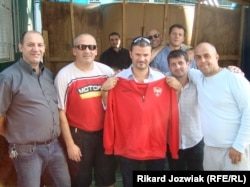 FC Kosova's president Abazi Xhevat (center) has big plans for the club.