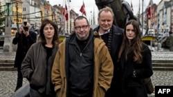 "Denmark - Director Lars Von Trier (C) and actors who starred in his ""Nymphomaniac"" film during its premiere in Copenhagen."
