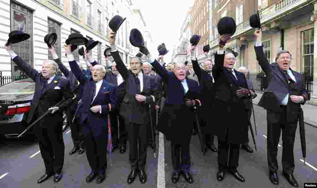 Members of London's In and Out raise their bowler hats as they prepare to march around St. James's Square to celebrate the 150th anniversary of the club on March 1. (Reuters/Paul Hackett)