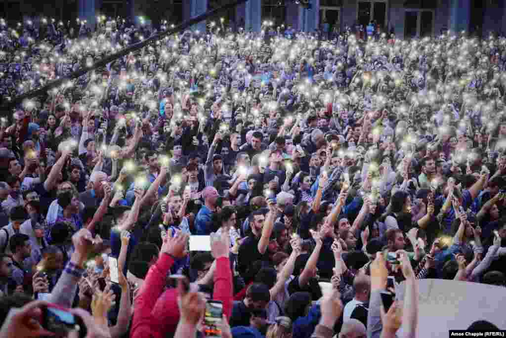 Protesters hold their phones aloft as Saralidze speaks to the crowd blocking Rustaveli Avenue on June 1.