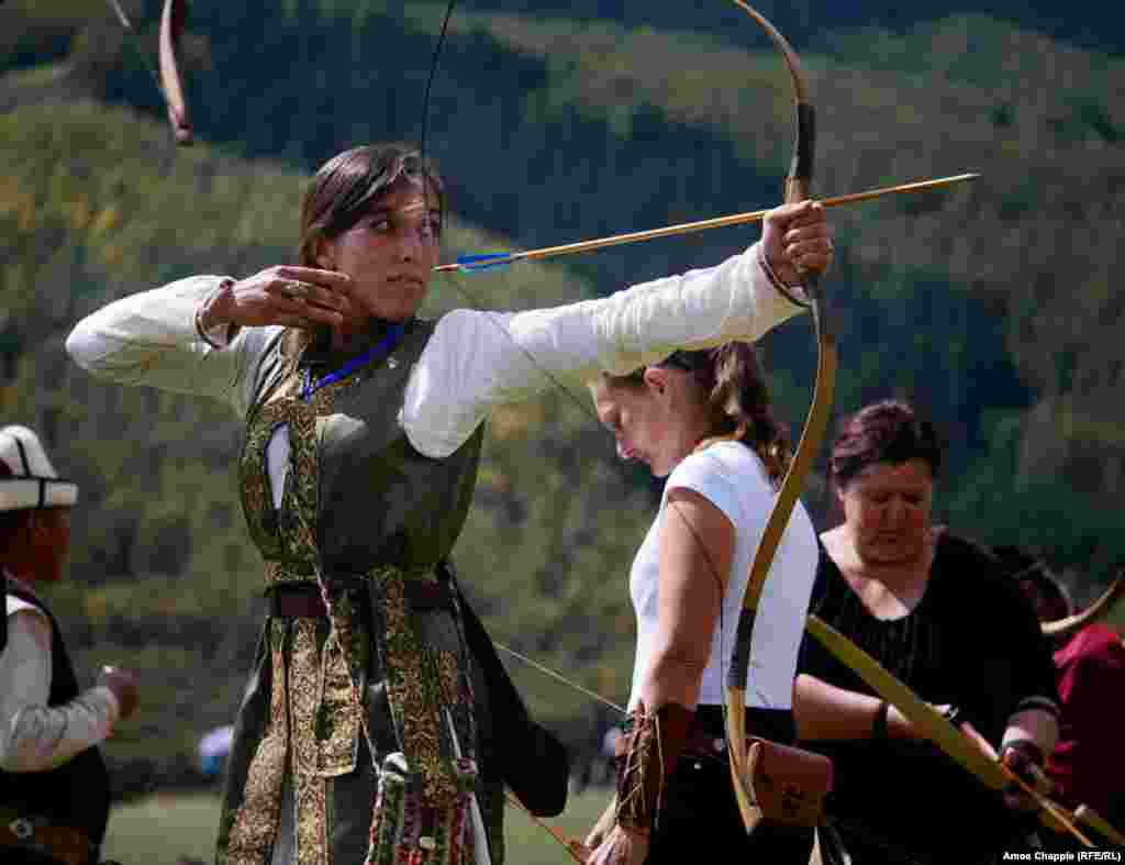 "Natalia Suarez Friedrichs looses an arrow during the women's archery. The Hungarian is in Kyrgyzstan for the first time and says Hungarians and Kyrgyz share the same roots. ""I love Hungary too much to leave, but I could definitely see myself living as a nomad, sleeping in a yurt. Some day, maybe."" In normal life, Natalia works for a courier company."
