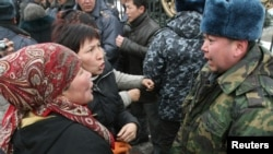 Kiosk operators argue with police during a protest in Bishkek on March 17.