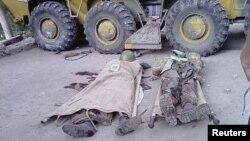 Тела солдат правительственных войск в Хороге, 24 июля