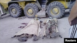 Bodies of government soldiers killed during a recent fighting lie on the ground in the town of Khorog, capital of the autonomous region of Gorno-Badakhshan, Jul2012