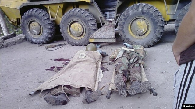 Bodies of government soldiers reportedly killed during recent fighting in the town of Khorog