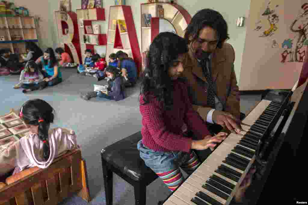 A girl attends a piano lesson at the Treehouse Nursery and Kindergarten.