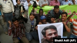 FILE: Pakistani journalists protest in Karachi, the capital of the southern province of Sindh.