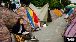 Chisinau protesters have set up about 250 tents, vowing not to go home until their demands are met.