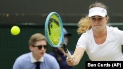 Українська тенісистка Дарія Снігур під час гри у фіналі Вімблдонського тенісного турніру. Лондон, 13 липня 2019 року