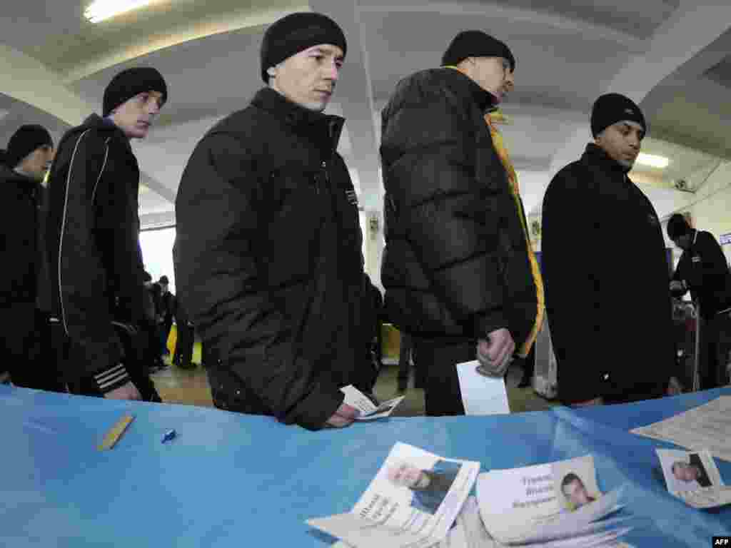 Ukrainian inmates wait their turn to vote inside a penitentiary in Lviv.