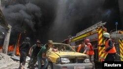 Козголоңчулар колундагы Идлиб шаарына абадан сокку урулгандан кийин. 12-июнь, 2016-жыл.