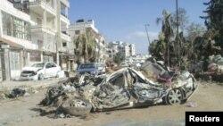 Ռմբակոծված շենքեր եւ ավտոմեքենաներ Սիրիայի Հոմս քաղաքում, 9-ը մարտի, 2012 թվական