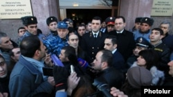 Armenia - Prosecutor-General Kostanian (C) addresses protesters in Gyumri, 15Jan2015.
