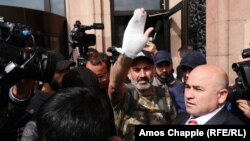 ARMENIA - Opposition leader Nikol Pashinian emerges from the Marriott Hotel after a short meeting with Prime Minister Serzh Sarkisian, 23 April 2018.