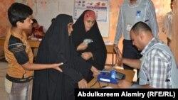 مرکز رأیگیری در بصره. ۳۰ آوریل ۲۰۱۴