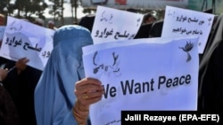 Afghans rally in support of the first round of the Doha peace talks between Taliban and the Afghan government on September 21, 2020.