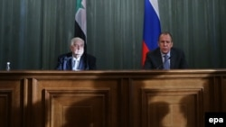 Russian Foreign Minister Sergei Lavrov (right) with his Syrian counterpart, Walid al-Mualem, at a news conference following their talks in Moscow on January 17