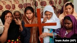 FILE: Pakistani Christians pray for Asia Bibi, a Catholic mother of five who has been on death row since 2010 accused of blasphemy in Multan (October).