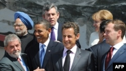 Indian Prime Minister Manmohan Singh (left) with other world leaders at a G8 summit in July.