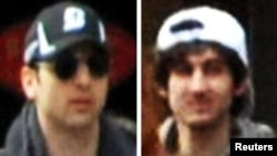 The suspects, Tamerlan (left) and Dzhokhar Tsarnaev, at the scene of the Boston Marathon bombings on April 15.