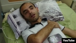 Rasim Aliyev on August 8 in the hospital after his beating