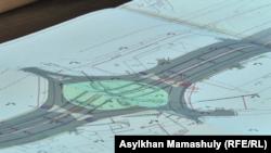 Проект многополосной дороги в районе крупного рынка в западной части Алматы.