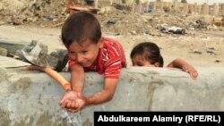 اطفال من معسكر القدس في البصرة