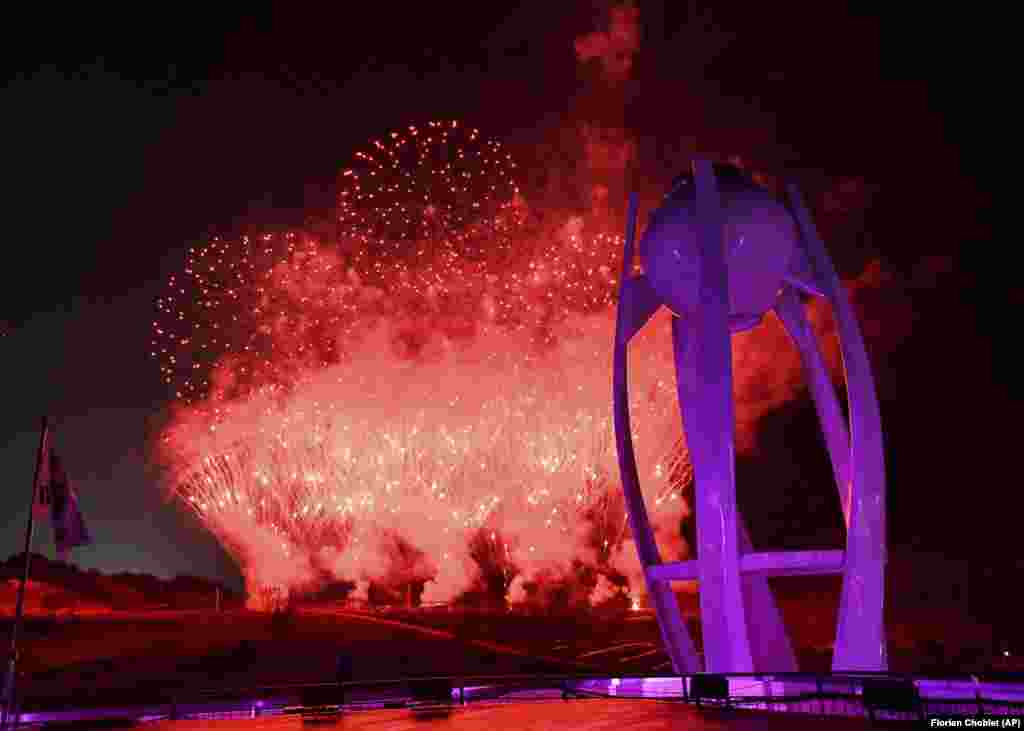 Closing Ceremony:Fireworks explode near the Olympic cauldron at the end of the closing ceremony of the 2018 Winter Olympics in Pyeongchang, South Korea, Sunday, February 25, 2018. (Florien Choblet/Pool Photo via AP)