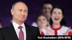 "Surrounded by beaming young activists at a volunteers' forum in Moscow on December 6, Russian President Vladimir Putin said he would make his decision on whether to run for president again ""soon."" A few hours later in Nizhny Novgorod, he officially announced his bid for reelection."