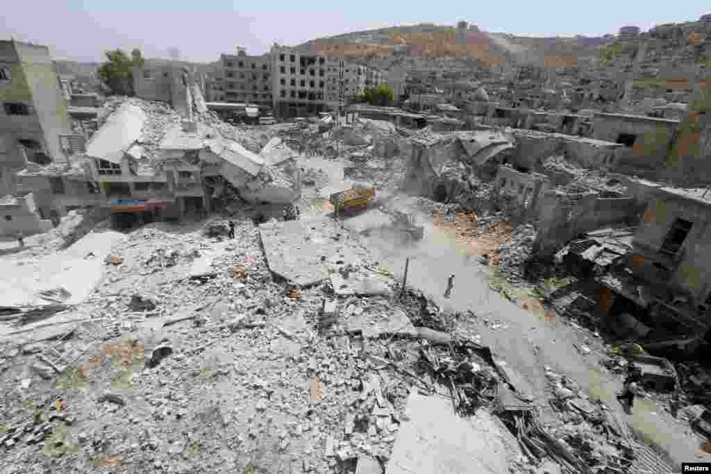 A general view shows the damage after a Syrian Army fighter jet crashed into a busy marketplace in the rebel-held northwestern town of Ariha. At least 27 people were killed and dozens injured. (Reuters/Ammar Abdullah)