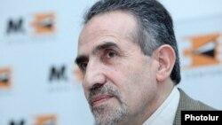 Armenia - Iranian Ambassador Mohammad Reisi hods a news conference in Yerevan, 6Dec2013.