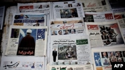 Images of approved and disqualified presidential candidates for the June election appear on the front pages of newspapers at a kiosk in Tehran on May 22.