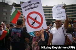 Protesters hold banners against the 5G technology and vaccines at an anti-government protest in front of the parliament in Sofia, Bulgaria, on May 14.