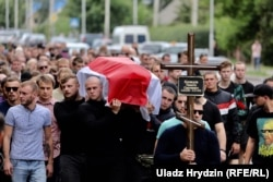 People attend the funeral of Mikita Kryutsou in Maladzyechna on August 25. Kryutsou disappeared after a protest on August 12. His body was found 10 days later. There are many questions still surrounding the nature of his death, although officials suggested it was suicide.