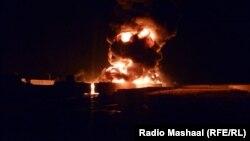Пожар, возникший после нападения боевиков на бензовозы для сил НАТО