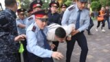 KAZAKHSTAN -- Law enforcement officers detain a man during an opposition rally held by critics of Kazakh President Kassym-Jomart Tokayev, who protest over his election in Almaty, Kazakhstan June 12, 2019.