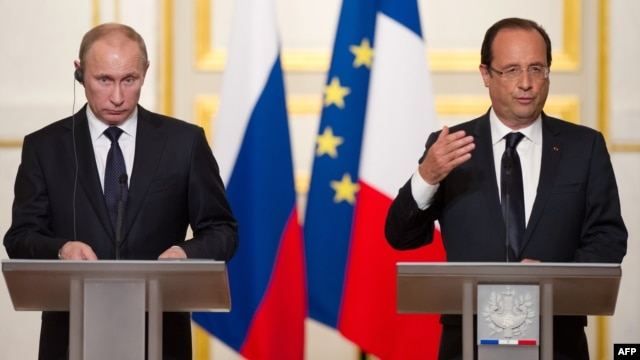 Russian President Vladimir Putin (left) met in Paris with French President Francois Hollande in June.