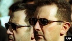 Президент Сирии Башар Асад (справа) и его младший брат Махер