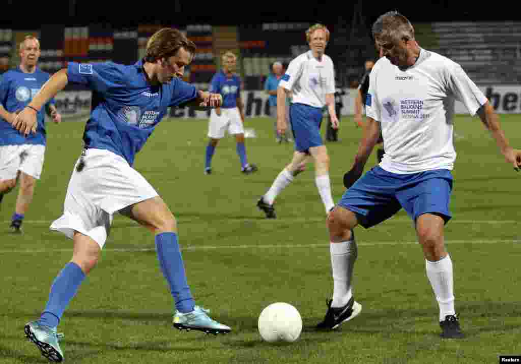Austrian Foreign Minister Sebastian Kurz (left) and Kosovar Foreign Minister Hashim Thaci fight for the ball during a politicians' soccer match ahead of the Western Balkans Summit in Vienna on August 26. (Reuters/Heinz-Peter Bader)