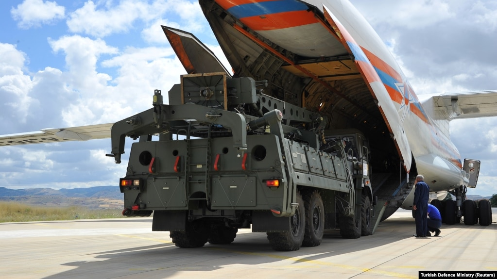 The first parts of a Russian S-400 missile-defense system are unloaded at an air base near Ankara on July 12.