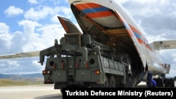 The first parts of a Russian S-400 missile defense system are unloaded from a Russian plane near Ankara on July 12.