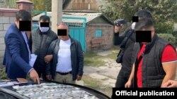 Фото с задержания, распространенное ГКНБ.
