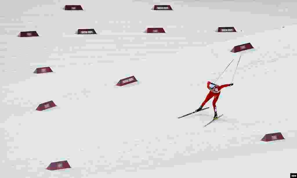 Dario Cologna of Switzerland in action during the men's 15km + 15km skiathlon competition in the Laura Cross Country Center. Cologna won the gold medal.