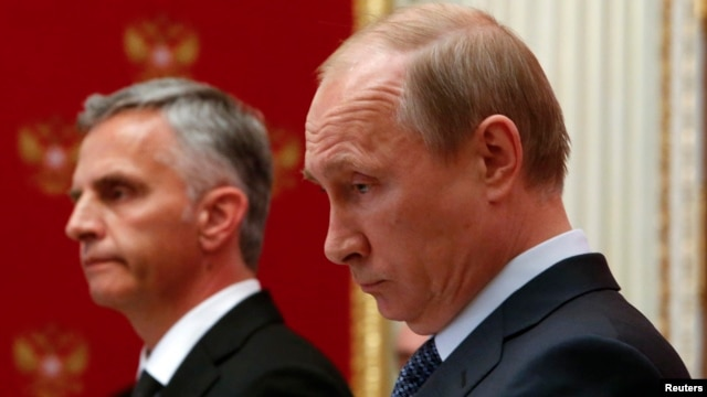 Russian President Vladimir Putin (right) and Swiss President and current OSCE Chairman Didier Burkhalter hold a press conference at the Kremlin in Moscow on May 7.