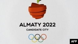 "The Olympic logo for Almaty, which hopes to host the 2022 Winter Olympics. Some say the city derives its name from the Kazakh word for ""apple"" and the surrounding region is believed to be the ancestral home of the now widely cultivated fruit."