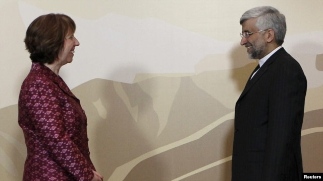 Iran's Chief negotiator Saeed Jalili (R) and European Union Foreign Policy chief Catherine Ashton stand for a photograph before talks in Almaty in April.