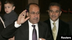 Iraqi's Prime Minister Nuri al-Maliki casting his vote for the Iraqi parliamentary elections.