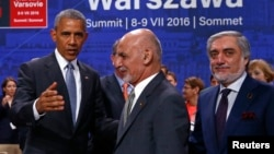 U.S. President Barack Obama (L) gestures next to Afghanistan's President Ashraf Ghani (C) and Afghanistan's Chief Executive Abdullah Abdullah at the NATO Summit in Warsaw, Poland on July 9.