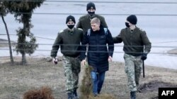 A man is detained in Minsk on March 25, one of at least 170 detained in the capital.